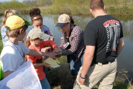 Students with teacher learning in the wetlands