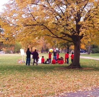 Golden leaves were still on the trees in Sloan's Lake Park in Denver at the end of October 2012 when preservice teachers from the education department at Metropolitan State University in Denver practiced their teaching in the outdoors with Colfax Elementary School students.