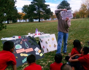 A science methods student from the education department at Metropolitan State University in Denver practices his teaching with Colfax Elementary School students, many of whom are English Language Learners, using a Project Learning Tree activity Signs of Fall in Sloan's Lake Park