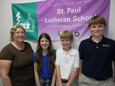 Teacher and students from St Paul Lutheran School in FL pose in front of their Certified PLT GreenSchools! banner