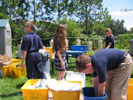 Students collect materials for recycling