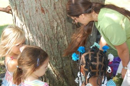 early childhood students with educator studying tree