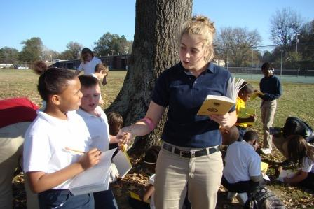 Young teacher takes classroom outdoors