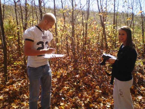 high-school-students-taking-notes-in-woods