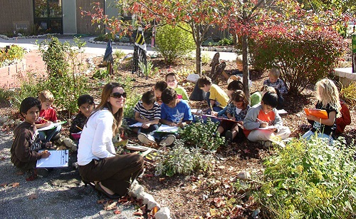 Bicentennial-elementary-school-students-and-teacher-drawing-in-school-yard