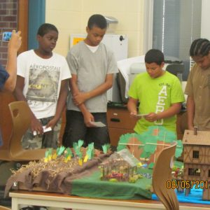 urban gardening students preparing for presentation of their farm model project