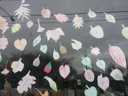 paper-cutouts-of-leaves-colored-and-taped-to-window