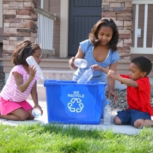 Family-recycling-outside-home