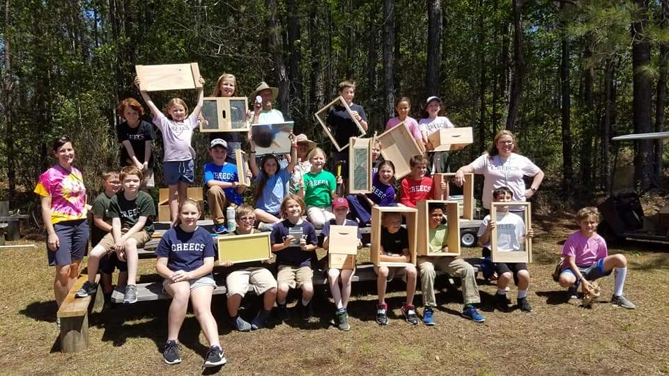 students-show-bee-boxes-frames