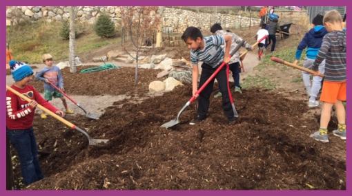 students mulching outdoors