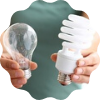 woman holding two types of light bulbs
