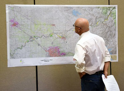 resident wearing glasses studies a park planning map in oakdale california