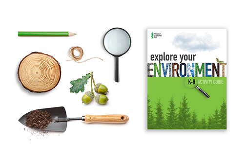Flat lay photo of PLT's K-8 Explore Your Environment Activity Guide and magnifying glass, acorns, string, and tree cookie
